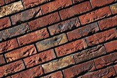 Rouge de mur de briques avec le jaune Photographie stock