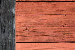 Rouge et dos en bois de mur Photo libre de droits