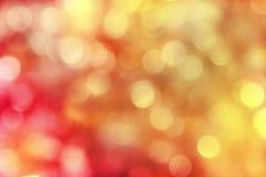 Rouge et fond scintillant de vacances d'or photos stock