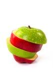 Rouge et pomme coupée en tranches par vert Photos stock