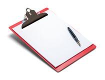 Rouge et stylo de presse-papiers image libre de droits