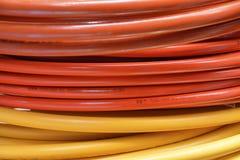 Rouge et tuyaux soudés par jaune Image libre de droits