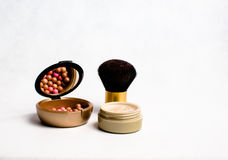 Rouge, face powder and brush for makeup Royalty Free Stock Images