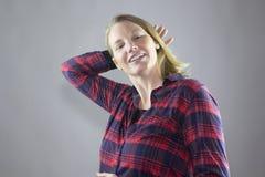 Rouge femelle de sourire 5 Images libres de droits