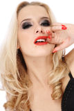 Rouge a levres. Portrait of blond girl with trendy makeup smudging her face by lipstick royalty free stock image