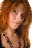 rouge malpropre d'une chevelure de cheveu de fille Photos stock