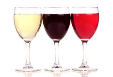Rouge, rose et vin blanc en glaces de vin Images stock