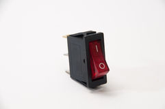 Rouge sur outre du commutateur sur le fond blanc Photographie stock libre de droits