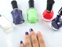 Rouge vert blanc de colur de vernis à ongles Photo stock