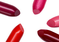 Rouges à lèvres sur un fond blanc Image stock