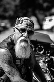 A Rough and aged Biker. And Motorcycle Club Member ready to get on his bike and ride with brothers Royalty Free Stock Photography
