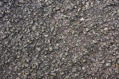 Rough asphalt road surface Stock Photo