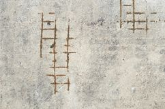 Rough backdrop of gray surface with rusty armature royalty free stock photo