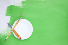Rough Background with Painting Instruments and a Plate Royalty Free Stock Image