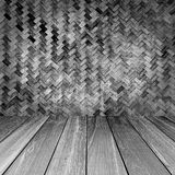 Rough bamboo weavewall with wood plank floor Stock Photography
