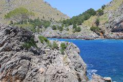 Blue bay of the Mediterranean Sea at Cala Sa Calobra, Mallorca, Spain Royalty Free Stock Images