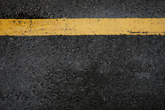 Rough black asphalt road and yellow traffic lines ,this image fo Stock Photography