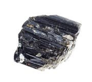 Rough black Tourmaline (Schorl) stone on white. Macro photography of natural mineral from geological collection - rough black Tourmaline (Schorl) stone on white stock photos