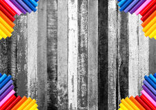 Rough black and white wood plank with colorful pencil at the cor Royalty Free Stock Photography