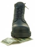 Rough boot. Treads on a money banknote Stock Photography