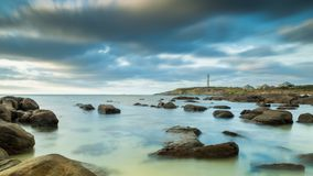 Lighthouse with dramatic clouds stock images