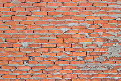 Rough brick masonry. With protruding from the joints with cement Royalty Free Stock Photo