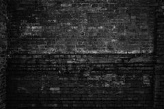 Rough brick wall, black and white photo. Grunge background stock image