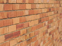 Rough brick wall of earth and terracotta colored bricks Royalty Free Stock Photos