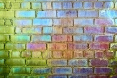 Rough brick wall iridescent colors of rainbow royalty free stock image
