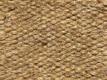 Rough brown camel wool fabric texture.Background. Rough brown camel wool fabric texture taken closeup as background Stock Image