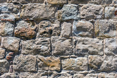 Rough brown natural stone wall Royalty Free Stock Images