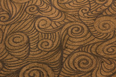 Rough brown spiral patterned background Stock Images