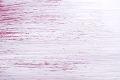 Rough brush strokes of white paint over pink Royalty Free Stock Photography