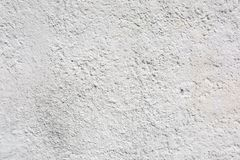 Rough Bumpy Sand Cement Stucco Texture on Wall. This is a perfect display of rough cement stucco on an exterior wall. A great texture background for graphic stock photography