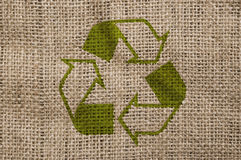 Rough canvas with recycle sign. Royalty Free Stock Image
