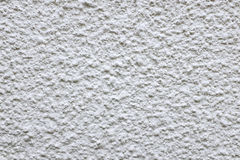Rough cement render painted white Stock Image