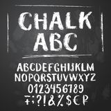 Rough chalk latin alphabet. On textured chalkboard background. Uppercase letters, numbers, sumbols, money signs royalty free illustration
