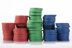 Rough Cheap Plastic Poker Chips in Stacks Royalty Free Stock Photos