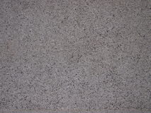 Rough concrete imitating granite. Used for the cladding of a house royalty free stock photos