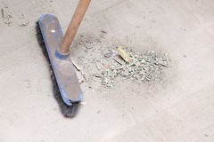 Rough concrete at a job site using a large broom Stock Image