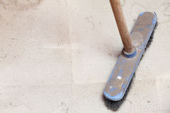 Rough concrete at a job site using a large broom Royalty Free Stock Images