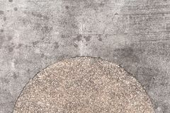 Rough concrete texture with pebbles decor. Grey asphalt road top view photo. Distressed and obsolete background texture. Gray concrete floor top view. Rustic Stock Photo