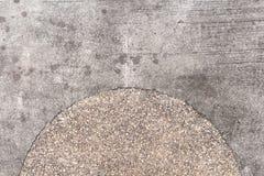 Rough concrete texture with pebbles decor. Grey asphalt road top view photo Stock Photo
