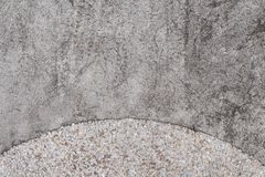 Rough concrete texture with pebbles. Grey asphalt road top view photo. Distressed and obsolete background texture. Natural concrete floor top view. Rustic Stock Images