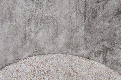 Rough concrete texture with pebbles. Grey asphalt road top view photo Stock Images