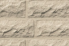 Rough concrete wall of beige color Stock Photos