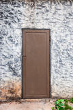 Rough Concrete Wall with Wood Door.  Royalty Free Stock Photo