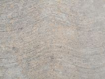 Rough concrete with wavy lines Royalty Free Stock Image