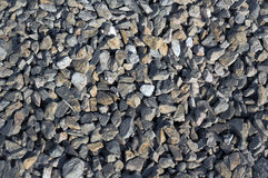 Rough construction rough stone. In the background Royalty Free Stock Photo