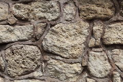Rough, crude  stone wall rendered with concrete Stock Images